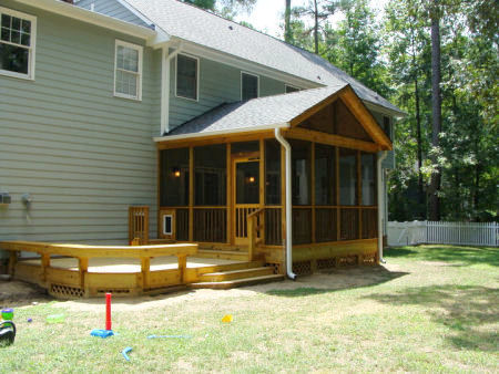 The view of the post and beam screened porch from the outside, showing the new deck