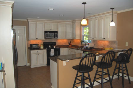 A wide view of the new kitchen, built by Raleigh Interiors Contractor Anthony and Company Construction